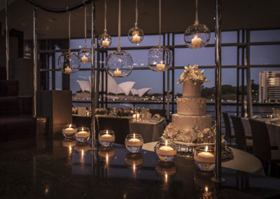 This beautiful candlelit wedding at world-renowned Quay Restaurant in Sydney, Australia included floating and hanging candles. Impeccably designed, made, delivered, and installed by the Susan Avery team. We even came back the next day and cleaned up!