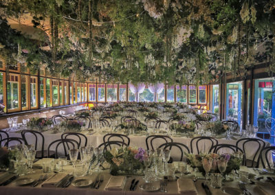 This rustic-look wedding at Vaucluse Tea Rooms in Sydney included crystal glasses and beautifully scented trough vase arrangements. Impeccably designed by Susan, and made, delivered, and installed by the Susan Avery team.
