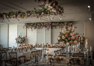 """A beautiful, """"shabby chic"""" and vintage wedding at Zest, Royal Motor Yacht Club in Sydney Australia included roses and seasonal foliages plus a 5x5 metre hanging arrangement. This installation was designed by Susan, and made, delivered, and installed by the Susan Avery team."""