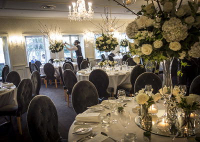 For a wedding at Dunbar House in Sydney's eastern suburbs, Susan designed these tall arrangements which included roses, hydrangea, pepper berry and jasmine. The arrangements were spectacularly shown off with mirrors and floating candles. Designed by Susan, and made, delivered, and installed by the Susan Avery team.